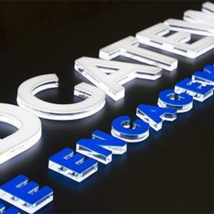 Embossed channel letter with G.O.Q. LED lighting