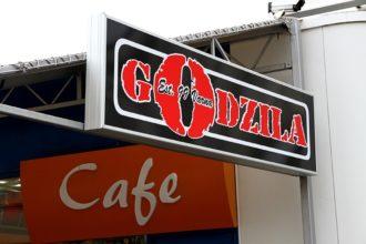 Illuminated signage for Godzila Restaurant