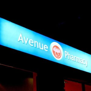 Illuminated advertising sign for Avenue Pharmacy