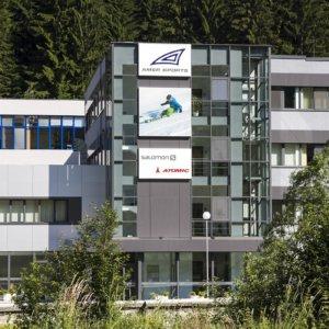 Illuminated sign for ski factory Amer Sport
