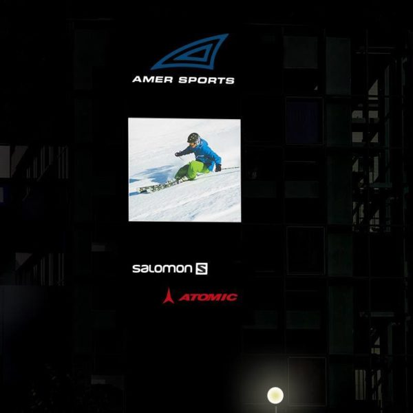 Illuminated sign with day/night perfo folio effect for Amer Sports