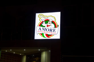 Illuminated sign for Amore Pizza Restaurant in Plovdiv