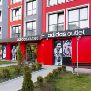 Adidas Outlet composite panel sign with embedded letters