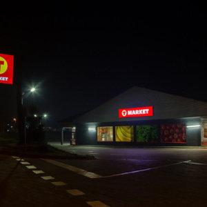 T-market sign at night