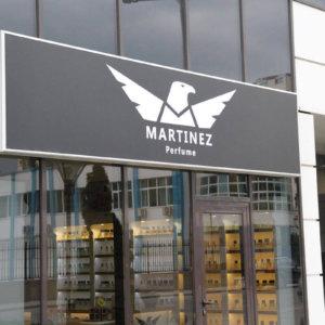 Illuminated sign with the logo of Martinez