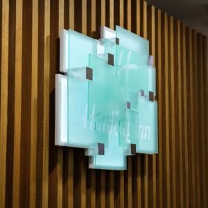 Illuminated plexiglas with multi-layered structure and distance holders