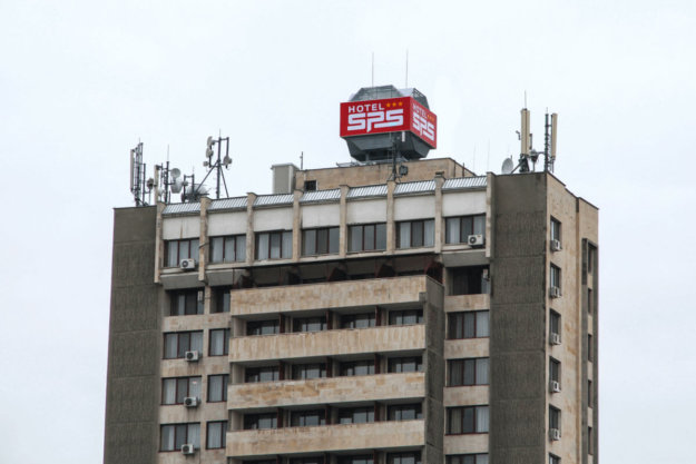 A big illuminated sign on the roof of Hotel SPS
