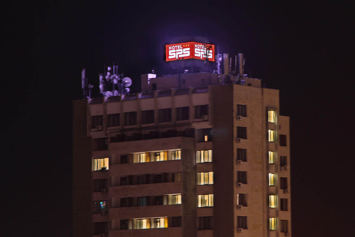 Illuminated advertisment cube on the roof of Hotel SPS - Plovdiv