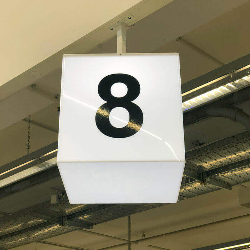 Illuminated box with number on a paycheck for stores interior signs
